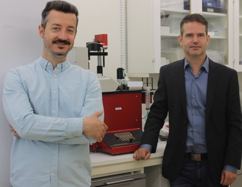 Dimitris Kanellis (left) and Mikael Lindstrand with a device that fractionates ribosomes.
