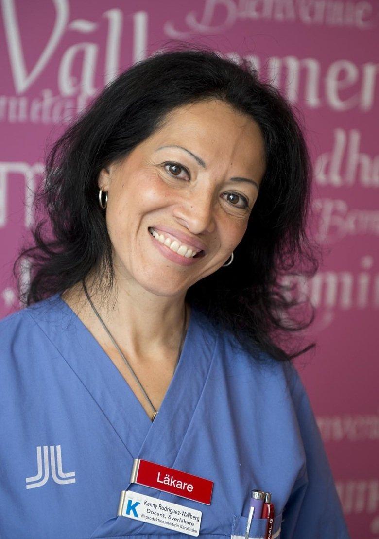 Portrait of Kenny Rodriguez-Wallberg in her doctor's coat