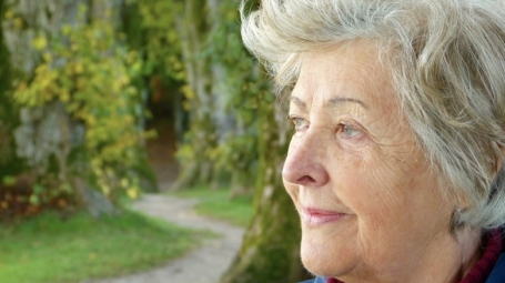Elderly woman with beautiful nature in the background