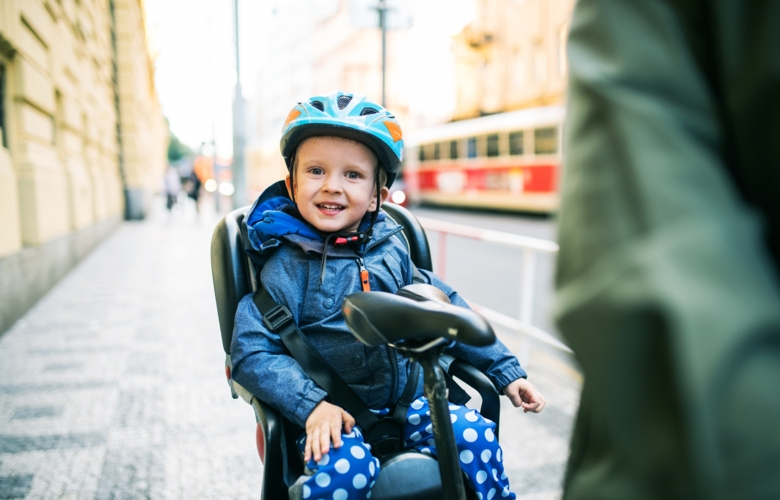 Smiling child with bicycle helmet.