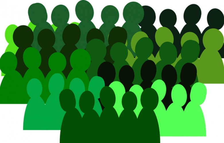 Green silhouettes of a group of people, illustrating a population, cohort, or statistics.