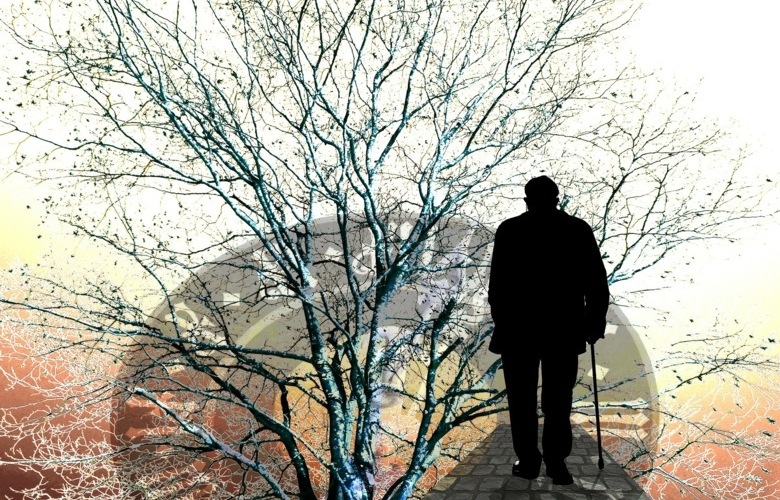 Illustration of ageing and dementia; a silhouette of an old man with a stick walking on a road, a large tree and a clock in the background.